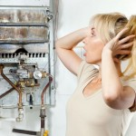 10769686 - the young woman is upset by that the gas water heater has broken